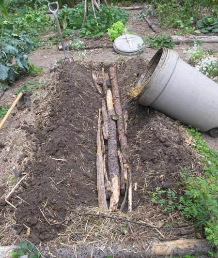 trench in garden and garbage can compost
