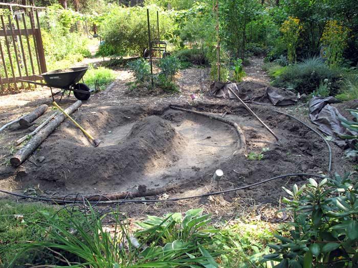 Starting to add log edges to rain garden